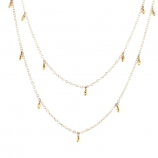 Silver Necklace with Gold Dangling Beads Image