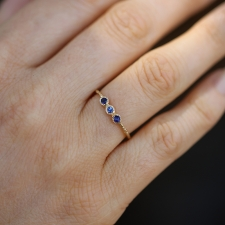 Triple Blue Sapphires on Textured Gold Band Image