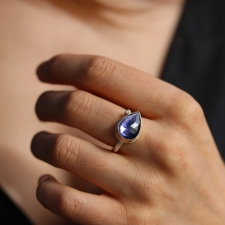 Sideways Teardrop Iolite Ring with Satellite Diamond Image