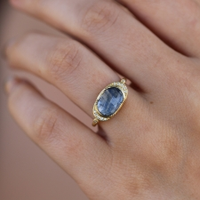 Blue Sapphire Ellipse Halo Ring Image