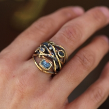 Twisted Ring with Sapphire and Diamonds Image